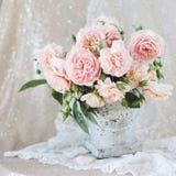 Vase of peach garden roses stock images