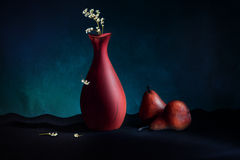 Vase and pears Stock Photos