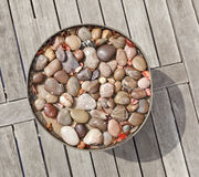 Vase with pebble stone decor Royalty Free Stock Photos