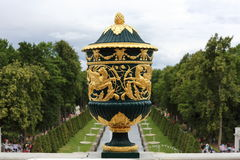 Vase in Peterhof, Russia. Vase decorated with golden lions and flowers on the terrace of Grand Peterhof Palace above Grand Cascade, Peterhof Royalty Free Stock Photos