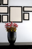 Vase and photo wall. Flower vase on table in front photo wall Royalty Free Stock Image