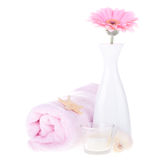 Vase with pink flower and towel Stock Image