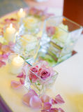 Wedding reception tables. Vase of pink roses and candles Stock Photo