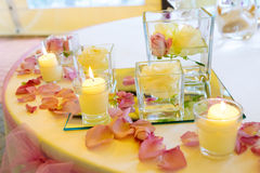 Wedding reception tables. Vase of pink roses and candles Stock Images