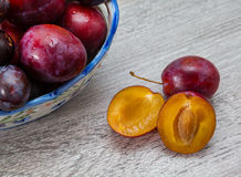 Vase with plums macro Royalty Free Stock Photo