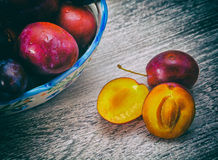 Vase with plums macro Royalty Free Stock Images