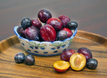 Vase with plums. wooden tray Royalty Free Stock Images
