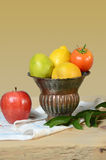 Vase with Produce on Table Royalty Free Stock Image