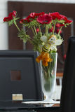 Vase with red poppies. Frosted glass vase with red poppies on the living room table Royalty Free Stock Photos
