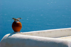 Vase on roof. One vase on myconian roof, myconos, greece Royalty Free Stock Image