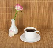 Vase with rose and cup of coffee Stock Images
