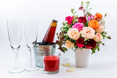 Vase of Roses bouquet, candle, and champagne glass Stock Images