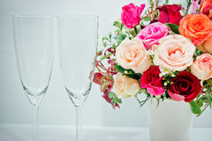 Vase of Roses bouquet and champagne glass. On white background, set of Beautiful flower Stock Photography