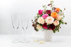 Vase of Roses bouquet and champagne glass. On white background, set of Beautiful flower Stock Images