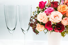 Vase of Roses bouquet and champagne glass. On white background, set of Beautiful flower Stock Photos