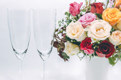 Vase of Roses bouquet and champagne glass. On white background, set of Beautiful flower Royalty Free Stock Images