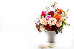 Vase of Roses bouquet on white background Royalty Free Stock Images