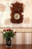 Vase of roses clock on the wall Royalty Free Stock Photo