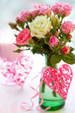 Vase of roses and hearts Stock Images