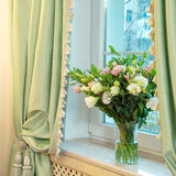 Vase with roses on the window Royalty Free Stock Photo