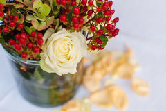 Bouquet of roses. Vase of roses yellow on table Stock Photography