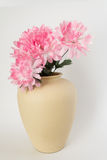 Vase with silk flowers. Beige vase with pink silk flowers on white background Stock Photos