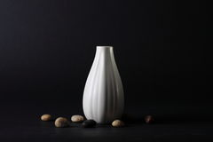 Vase and stones. Textured white vase and small stones Royalty Free Stock Photography