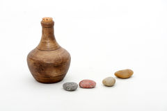 Vase and stones. With white background stock images