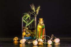Vase with stones light yellow light royalty free stock photo