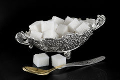 Vase with sugar. The silver vase with sugar is photographed on a black background Royalty Free Stock Photo