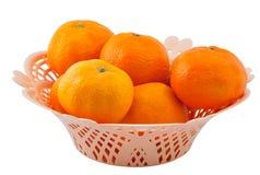 Vase with tangerines Stock Image