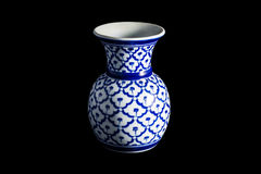 Vase on a traditional with isolated on black background. Royalty Free Stock Photo
