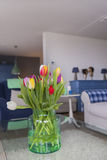 Vase with tulips in interior Stock Images