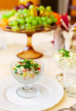Vase with vegetable salad on a table Stock Photography