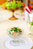 Vase with vegetable salad on a table Royalty Free Stock Photo