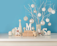 Vase in white knitted cover with white branches and Christmas to Stock Photos