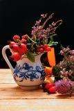 Vase with wild berries Stock Photos