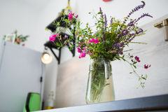 Vase with wild flowers on the table. Kitchen in the style of Provence. On the table is a vase with wild flowers Stock Images