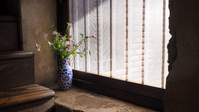 Vase beside window. Flower vase by the window in vintage style Stock Photography