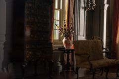 A vase in the window of a vintage colonial model home. royalty free stock photography