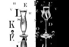 A vase and a wineglass. With Latin letters and small glass balls Stock Photography