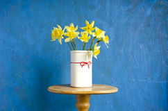 Vase with yellow narcissus Stock Photos