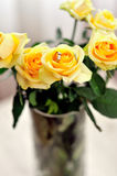 Vase with yellow roses Stock Image