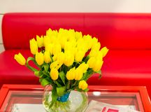 Vase of yellow tulips in modern  living room Royalty Free Stock Image