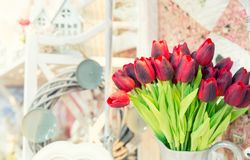 Vase of yellow tulips in modern  living room Royalty Free Stock Photos
