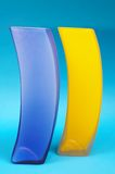 Vases. Blue and yellow vases against blue background stock image