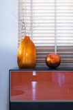Vases with the branches in the interior royalty free stock photography