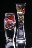 Vases en verre sur le noir Image stock