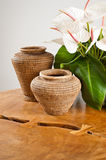 Vases and flowers as interior decoration Stock Photos