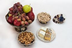 Vases with fruit, cookies and nuts Stock Photo